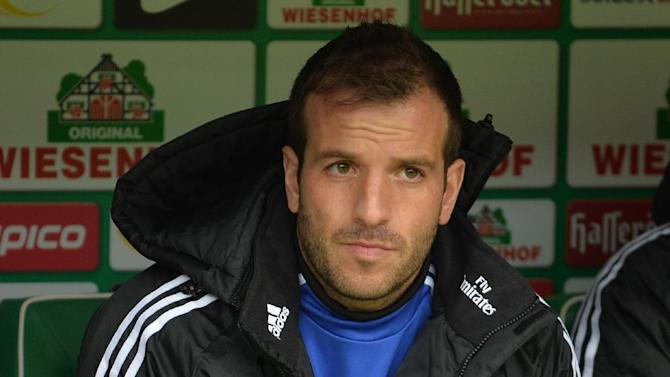 Hamburg's Rafael van der Vaart waits on the bench prior to the German Bundesliga soccer match between SV Werder Bremen and HamburgSV,  in Bremen, northern Germany, Saturday March 1, 2014