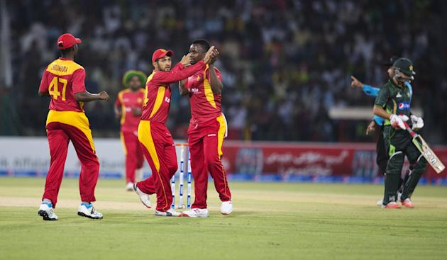Zimbabwe players celebrate the dismissal of Pakistan's Ahmed Shahzad during a match at the Gaddafi Stadium in Lahore, Pakistan, Sunday, May 24, 2015. The Twenty20 matches Friday and Sunday mark a