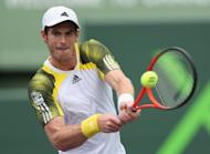 Andy Murray plays a backhand return to Grigor Dimitrov on March 25, 2013. Murray blasted nine aces en route to a 7-6 (7/3), 6-3 victory over the Bulgarian in the third round of the Miami Masters