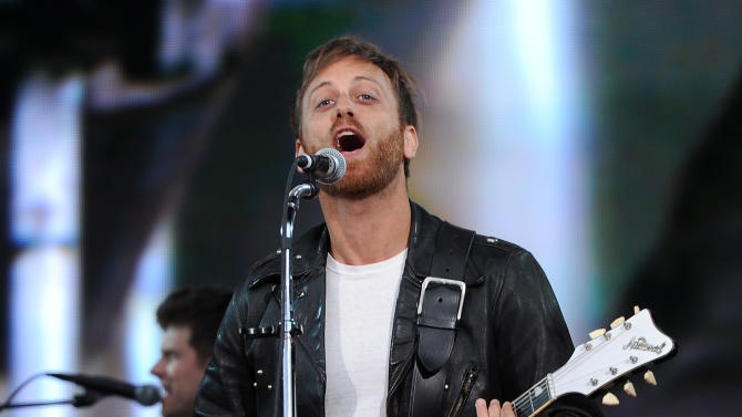 FILE - In this Sept. 29, 2012 file photo, guitarist Dan Auerbach of The Black Keys performs at the Global Citizen Festival in New York's Central Park. The Black Keys are remaining vigilant when it comes to sound-a-like songs.  The Nashville duo is suing Pinnacle Entertainment in New York federal court.  (Photo by Evan Agostini/Invision/AP, File)