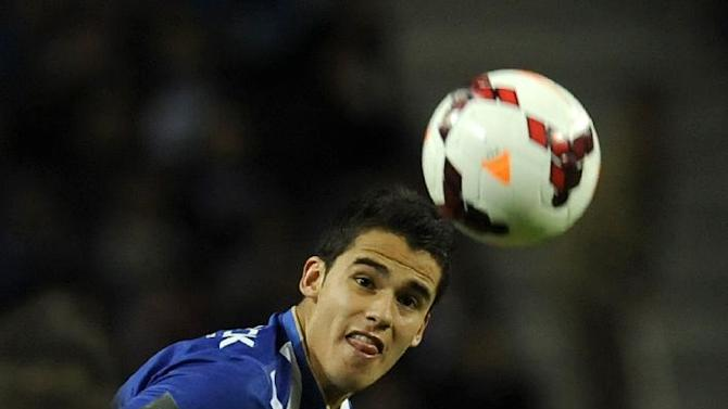FC Porto's Diego Reyes from Mexico, vies for a high ball with Benfica's Oscar Cardozo, back, from Paraguay in a Portugal Cup semifinal first leg soccer match at the Dragao stadium in Porto, Portugal, Wednesday, March 26, 2014