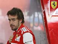 Ferrari Formula One driver Fernando Alonso of Spain looks on during the third practice session of the Korean F1 Grand Prix at the Korea International Circuit in Yeongam, October 5, 2013. REUTERS/Lee Jae-Won