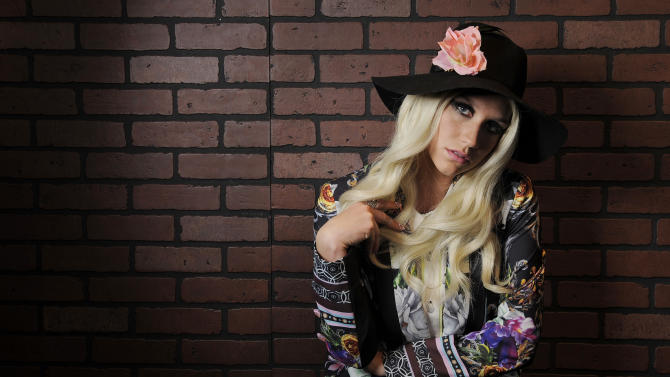 "In this Tuesday, Nov. 13, 2012 photo, singer-songwriter Ke$ha poses for a portrait in Los Angeles. Ke$ha co-wrote five songs on her newly released album ""Warrior,"" with her mother Pebe Sebert, a singer-songwriter from Tennessee who penned ""Old Flames Can't Hold a Candle to You,"" a hit for Dolly Parton in 1980. She says she learned about songwriting by sneaking into her mother's sessions as a child.  (Photo by Chris Pizzello/Invision/AP)"