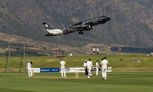 An Air New Zealand jet takes off behind a cricket field in Queenstown on February 27, 2013