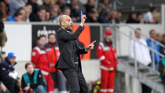 Bayern head coach Pep Guardiola of Spain gestures during a German first division Bundesliga soccer match between TSG 1899 Hoffenheim and Bayern Munich in Sinsheim, Germany, Saturday, Nov.2, 2013