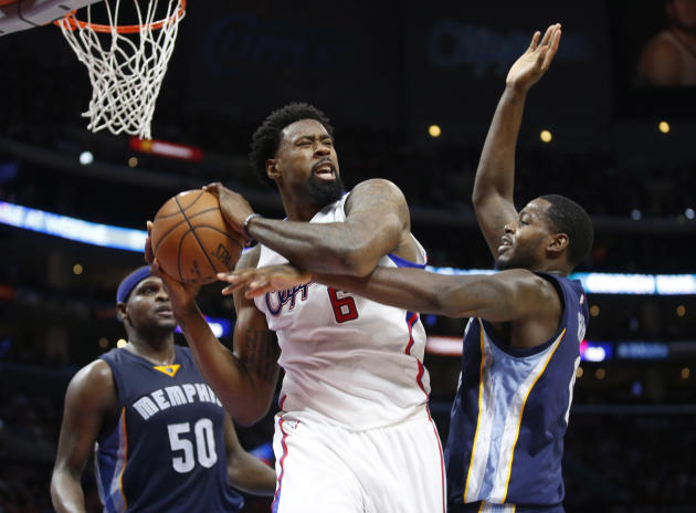 FILE - In this Saturday, April 11, 2015 file photo, Los Angeles Clippers' DeAndre Jordan brings in a rebound in front of Memphis Grizzlies' Zach Randolph, left, and JaMychal Green, right, duri