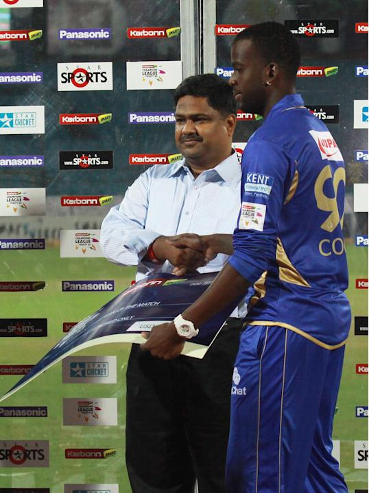 Rajasthan Royals bowler Kevon Cooper receiving Player of the Match award against Perth Scorchers during the CLT20 match at Sawai Mansingh Stadium, Jaipur on Sept. 29, 2013. (Photo: IANS)