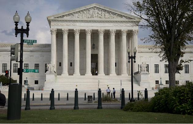 FILE - The Supreme Court Building is shown in this, Thursday, Sept. 18, 2014 file photo in Washington. President Barack Obama's health care overhaul has survived a barrage of Republican-led repeal vot