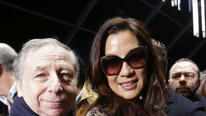 Todt and Michelle Yeoh pose at the Roberto Cavalli's Autumn/Winter 2015/16 collection during Milan Fashion Week
