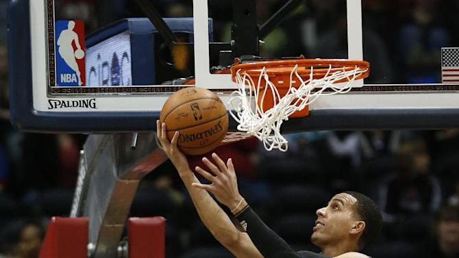 Minnesota Timberwolves guard Kevin Martin scores in the first half of an NBA basketball game against the Atlanta Hawks on Saturday, Feb. 1, 2014, in Atlanta. The Hawks won 120-113