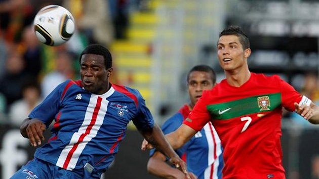 Cape Verde's Varela (L) heads the ball next to Portugal's Cristiano Ronaldo during their friendly