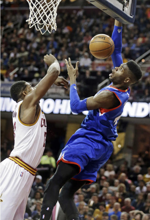 Philadelphia 76ers' Nerlens Noel, right, loses the ball against Cleveland Cavaliers' Tristan Thompson in the second quarter of an NBA basketball game Sunday, March 29, 2015, in Cleveland. (AP