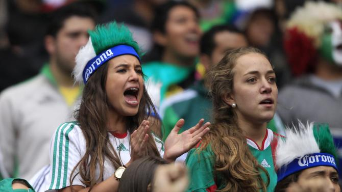 Fans of Mexico watch their soccer match against New Zealand at the Azteca stadium in Mexico City