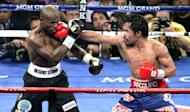 """Manny Pacquiao (R) lands a punch on Timothy Bradley's face during their WBO welterweight title fight on June 9. Promoter Bob Arum said he would ask the Nevada attorney general's office """"for a full and complete inquiry"""" into the controversial Bradley-Pacquiao title fight"""