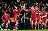 Liverpool's English defender Martin Kelly (R) celebrates scoring the second goal with English striker Andy Carroll (L) during their League Cup football match against Chelsea at Stamford Bridge, London. Liverpool won 2-0