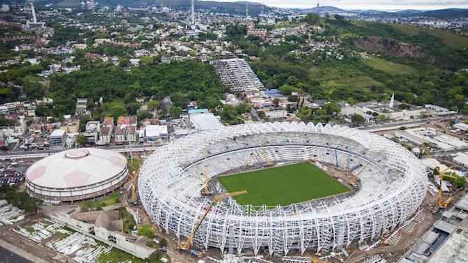 In this photo released by Portal da Copa 2014, an aerial view of the Arena Beira Rio stadium, in Porto Alegre, Brazil, Oct. 2013. The draw for the 2014 World Cup finals takes place Friday Dec. 6, 2013 near Salvador, Brazil. The 32 teams will be drawn into eight groups of four. The top two in each group will progress to the knockout stages. Twelve stadiums in twelve cities will host matches