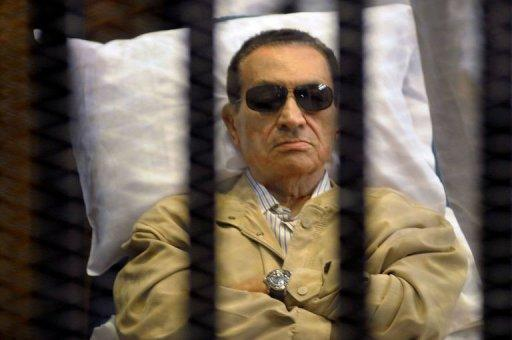Ousted Egyptian president Hosni Mubarak sits inside a cage in a courtroom during his verdict hearing in Cairo on June 2, 2012. Mubarak, who is serving a life sentence, was injured when he slipped in a prison shower on Saturday, the official MENA news agency reported