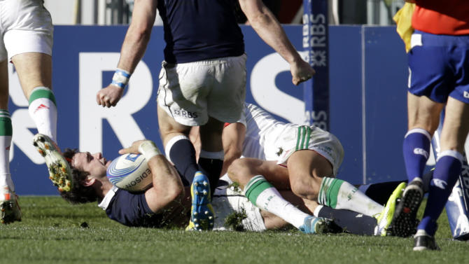 Scotland's Alex Dunbar, on the ground, scores during a Six Nations rugby union international match between Italy and Scotland, in Rome, Saturday, Feb. 22, 2014. (AP Photo/Andrew Medichini)
