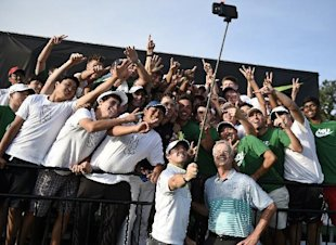 Rory McIlroy uses a selfie stick to take a photo with many of the 54 golfers at the Junior Invitational golf tournament, after speaking to them following the second round at Sage Valley Golf Club in Graniteville, S.C., on Friday, April 24, 2015. (Jon-Michael-Sullivan/The Augusta Chronicle via AP)