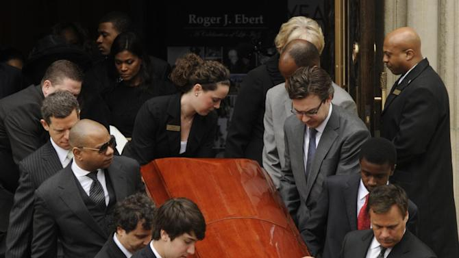 Pallbearers carry the casket of film critic Roger Ebert after his funeral at Holy Name Cathedral in Chicago, April 8, 2013. The Pulitzer Prize-winning movie reviewer died Thursday, April 4 at age 70 after a long battle with cancer. (AP Photo/Paul Beaty)