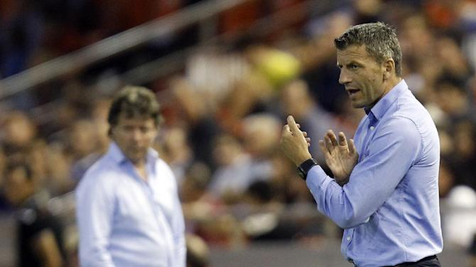 Valencia's coach Miroslav Djukic from Serbia gestures to his players during their Europa League Group A soccer match against St Gallen at the Mestalla stadium in Valencia, Spain, Thursday Oct. 24, 2013