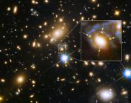 Multiple images of a single distant supernova within a cluster of galaxies called MACS J1149.6+2223, located more than 5 billion light-years away, are seen in an image from NASA taken by the Hubble Space Telescope released March 5, 2015. In the enlarged inset view of the galaxy, the arrows point to the multiple copies of the exploding star, dubbed Supernova Refsdal, located 9.3 billion light-years from Earth. The images are arranged around the galaxy in a cross-shaped pattern called an Einstein Cross. The blue streaks wrapping around the galaxy are the stretched images of the supernova's host spiral galaxy, which has been distorted by the warping of space. REUTERS/NASA/Handout via Reuters (OUTER SPACE - Tags: SCIENCE TECHNOLOGY) FOR EDITORIAL USE ONLY. NOT FOR SALE FOR MARKETING OR ADVERTISING CAMPAIGNS