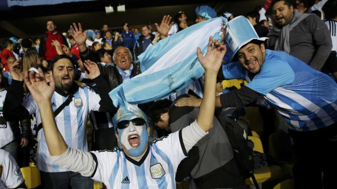 Argentina fans cheer as they await the start of the team's Copa America 2015 semi-final soccer match against Paraguay at Estadio Municipal Alcaldesa Ester Roa Rebolledo in Concepcion