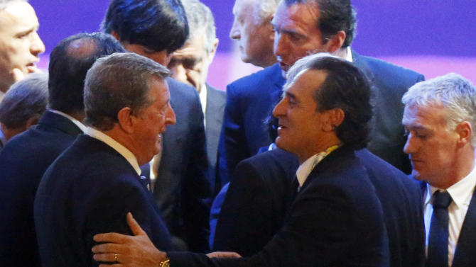 Italy's coach Cesare Prandelli speaks to England manager Roy Hodgson after the draw for the 2014 World Cup finals was made at the Costa do Sauipe resort in Sao Joao da Mata