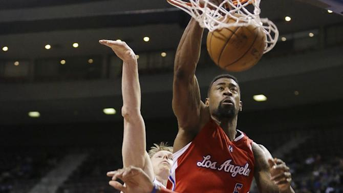 Los Angeles Clippers center DeAndre Jordan (6) dunks over Detroit Pistons center Andre Drummond (0) and forward Kyle Singler during the second half of an NBA basketball game in Auburn Hills, Mich., Monday, Jan. 20, 2014