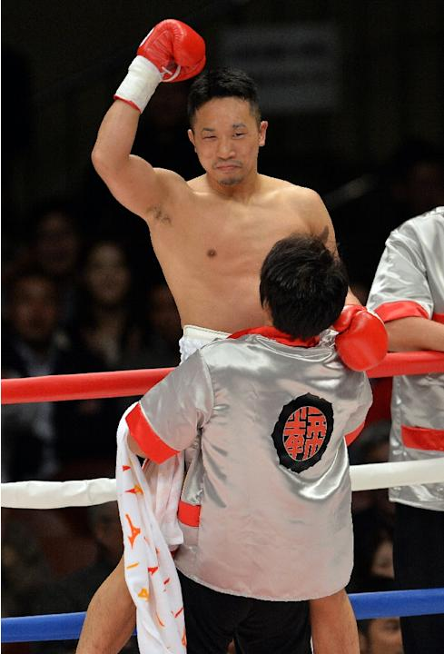 Former WBC featherweight champion Takahiro Ao is carried after he wins at a 10-round boxing match in Tokyo on November 10, 2013