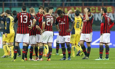 AC Milan's players react at the end of their Champions League round of 16 first leg soccer match against Atletico Madrid at the San Siro stadium in Milan February 19, 2014. REUTERS/Alessandro Garofalo