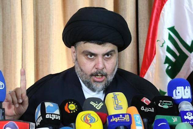 Iraqi Shiite cleric Moqtada al-Sadr delivers a speech from the southern city of Najaf on February 18, 2014