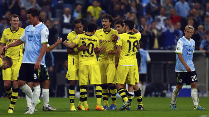 Dortmund players celebrate after their second round German soccer cup match against TSV 1860 in Munich