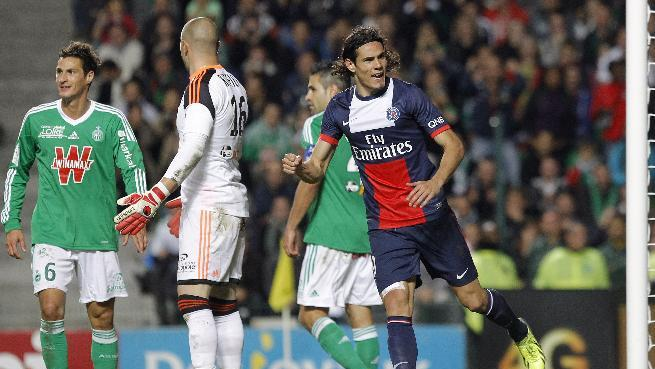 Paris Saint Germain's Edinson Roberto Cavani, right, celebrates after a goal against Saint-Etienne during their French League One soccer match in Saint-Etienne, central France, Sunday, Oct. 27, 2013