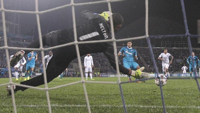 Porto's goalkeeper Helton makes a save on Zenit's Hulk's penalty kick, center right, during the Champions League group G soccer match between Zenit and Porto at Petrovsky stadium in St.Petersburg, Russia, Wednesday, Nov. 6, 2013