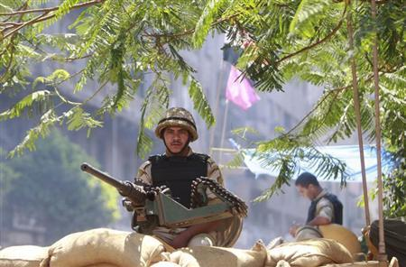 A soldier mans a machine gun on top of an armoured personnel carrier (APC) near the al-Fath mosque on Ramses Square in Cairo, September 11, 2013. REUTERS/Mohamed Abd El Ghany