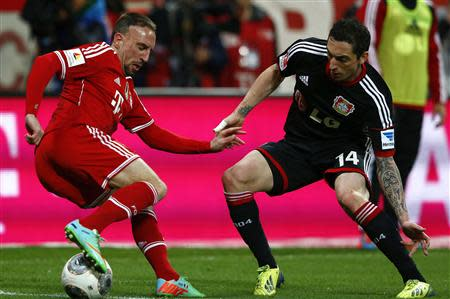 Leverkusen's Hilbert challenges Munich's Ribery during their German first division Bundesliga soccer match in Munich