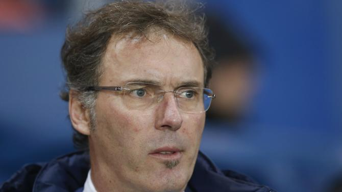 Paris St-Germain's coach Blanc looks on before French Ligue 1 soccer match against Lille in Paris