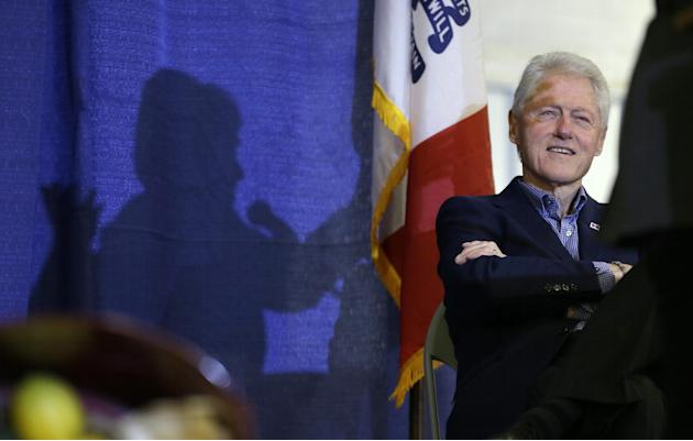 FILE - In this Nov. 15, 2015 file photo, former President Bill Clinton listens to his wife, Democratic presidential candidate Hillary Rodham Clinton speak in Ames, Iowa. The former president is going