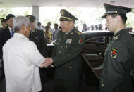 Chinese Defense Minister Liang Guanglie, center, bids goodbye to his Philippine counterpart Voltaire Gazmin, left, at the Defense Headquarters in suburban Quezon City, north of Manila, Philippines on Monday May 23, 2011. Guanglie's visit comes amid renewed tension over the disputed Spratly's Islands which are claimed by China, Philippines and four other asian countries and terrotorites. Washington has expressed concerns that the disputes could hamper access to one of the world's busiest commercial sea lanes.