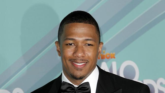 FILE - In this Oct. 26, 2011 photo, Nick Cannon arrives at the third annual TeenNick HALO awards in Los Angeles. Cannon, was hospitalized for kidney failure in January and later diagnosed with lupus nephritis, is documenting his recovery in a web series which debuted earlier this month. (AP Photo/Matt Sayles, file)