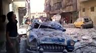 "An image grab taken from a video uploaded on YouTube on August 7 shows Syrians inspecting damages in the Bustan al-Qasr district of the northern city of Aleppo. President Bashar al-Assad vowed on Tuesday to crush the 17-month rebellion against his regime and to cleanse Syria of ""terrorists,"" as his troops engaged rebels in Aleppo"