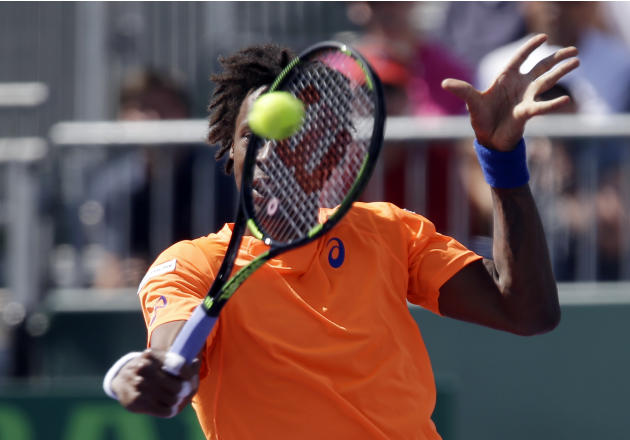 Gael Monfils, of France, returns to Jo-Wilfried Tsonga at the Miami Open tennis tournament, Sunday, March 29, 2015, in Key Biscayne, Fla. (AP Photo/Alan Diaz)