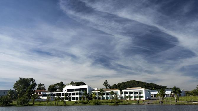 In this Feb. 4, 2014 photo, the JN Resort sits on the banks of a body of water in Sete Lagoas, Brazil. Uruguay's soccer team will be based at this hotel during the 2014 FIFA World Cup tournament