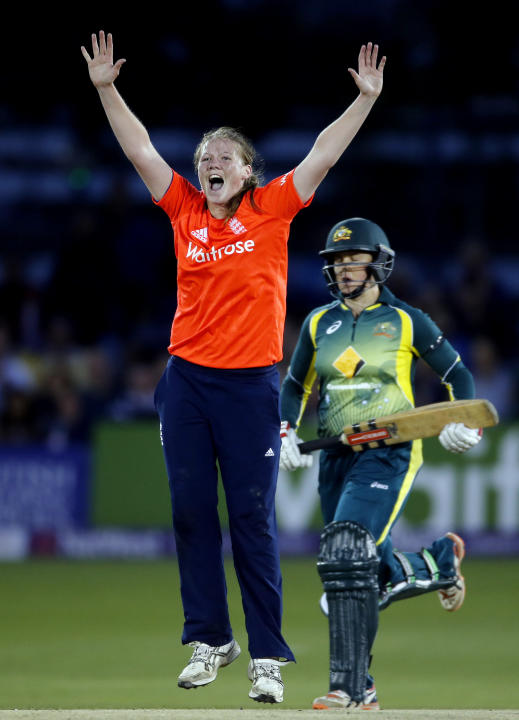 England's Anya Shrubsole celebrates the wicket of Australia's Grace Harris (right)
