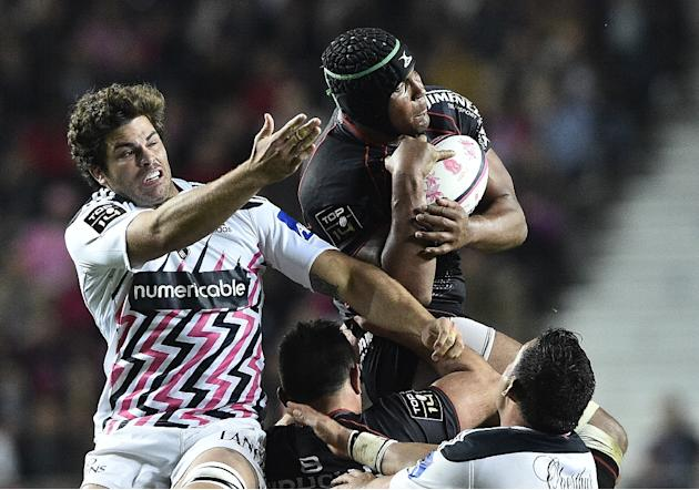 Toulouse's French flanker Thierry Dussautoir (R) grabs the ball next to Paris' American flanker Scott LaValla during the French Top 14 rugby match between Stade Francais Paris and Toulouse on