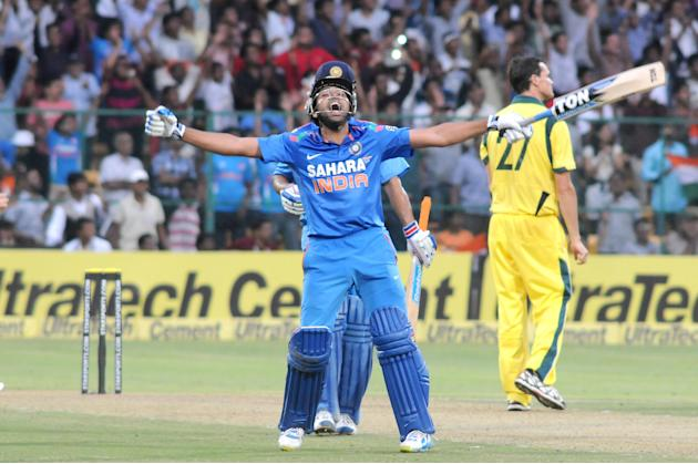 Indian player Rohit Sharma celebrates his 200 runs during the 7th ODI between India and Australia played at Chinnaswamy Stadium in Bangalore on Nov.2, 2013. (Photo: IANS)