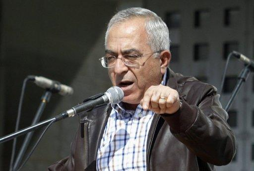 "Palestinian prime minister Salam Fayyad, pictured here on November 3, 2012, on Sunday urged Arab League nations to make good on $100 million a month in pledged ""safety net"" funds, warning that his government was facing a ""dangerous"" financial crisis"