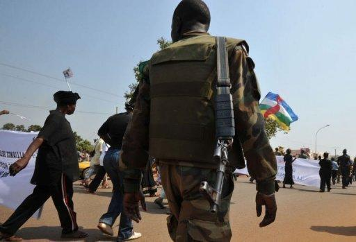 A soldier ensures security during a women's march in Bangui against the conflict in the Central African Republic on December 28, 2012. The Central African Republic's neighbours took steps Friday to tackle the crisis in the chronically unstable nation, where rebels have advanced towards the capital Bangui, stoking local and international alarm.