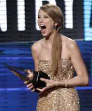 "Taylor Swift accepts the award for country favorite album for ""Speak Now"" at the 39th Annual American Music Awards on Sunday, Nov. 20, 2011 in Los Angeles. (AP Photo/Matt Sayles)"
